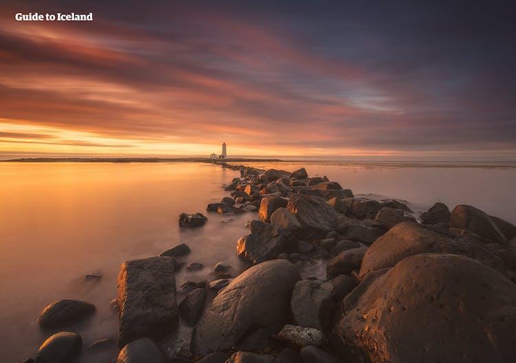 The sunset hitting the rocks of Grótta Beach in Iceland's capital city Reykjavík.