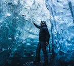 Man in Ice Cave touching the ice