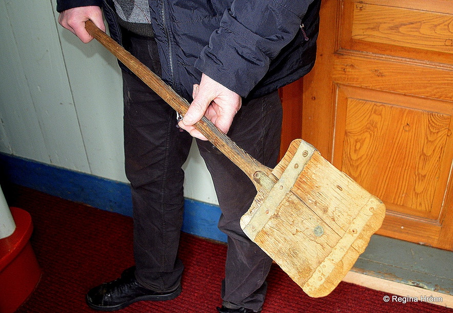 The farmer at Prestbakki holding a shovel, which is a part of the burial tools of the church