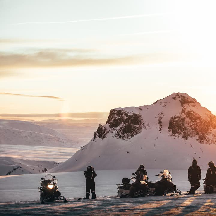A group of snowmobiling tourists
