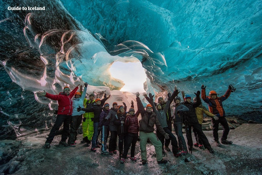 A happy tour group in an ice cave