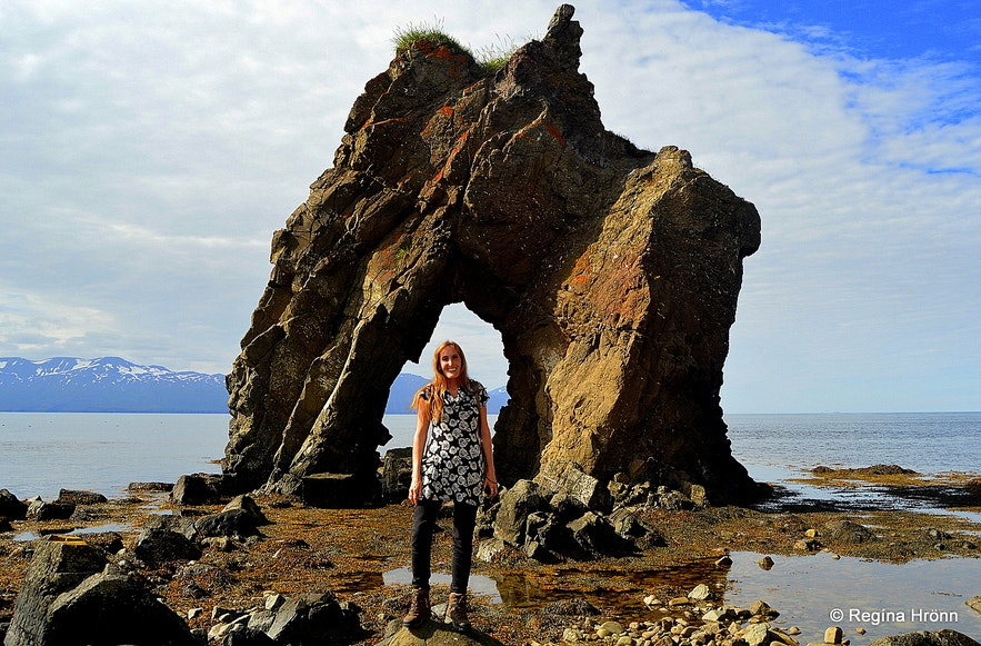 Regína by the Gatanöf arch-rock on Bakkahöfði cape North-Iceland