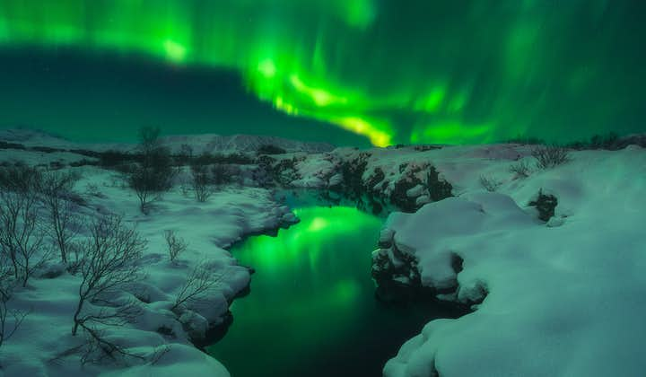 The Northern Lights in Iceland lighting up a snowy scene