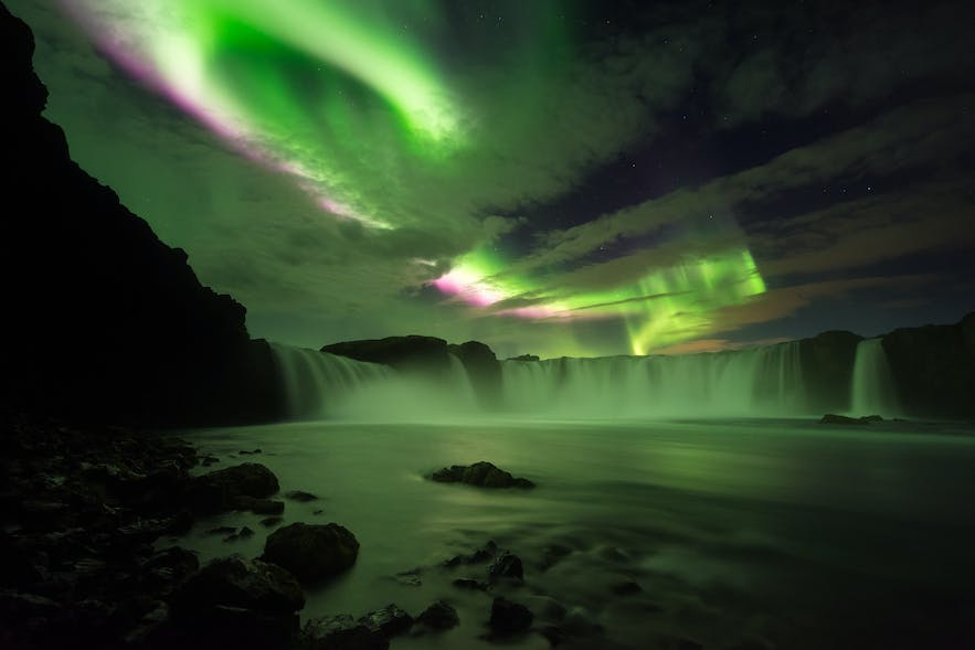 Godafoss waterfall in North Iceland with the aurora in the sky