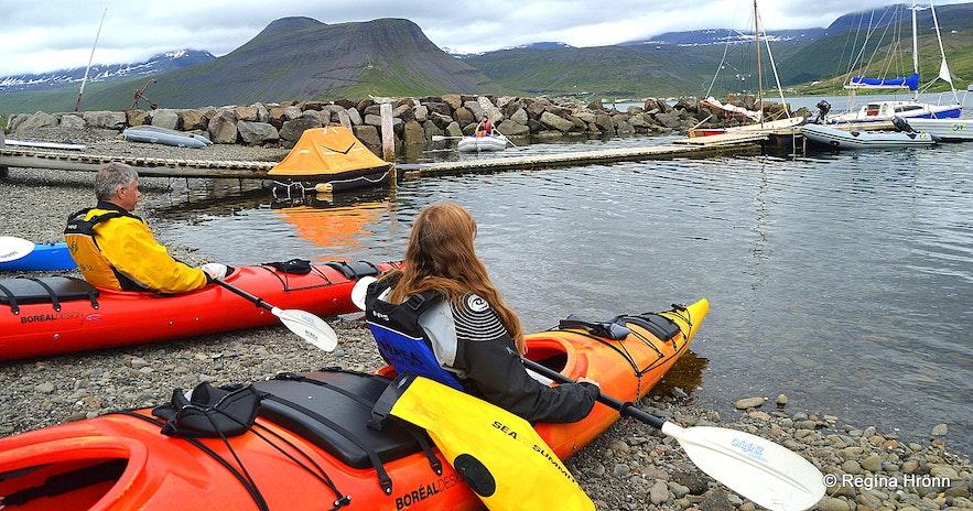 Regína Kayaking by Ísafjörður town in the Westfjords of Iceland