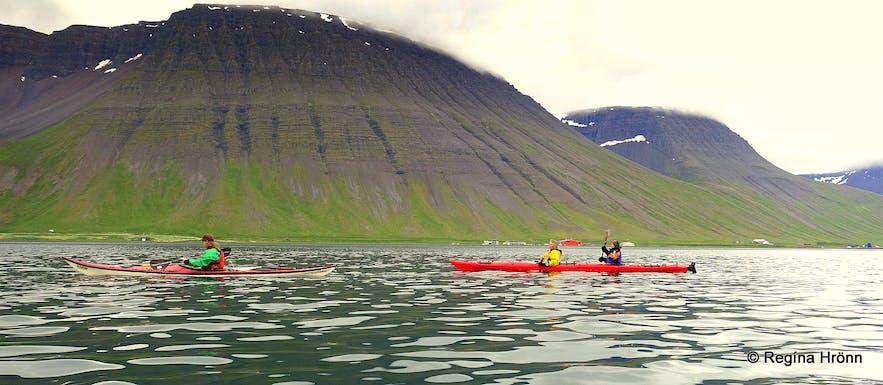 Kayaking by Ísafjörður town in the Westfjords of Iceland