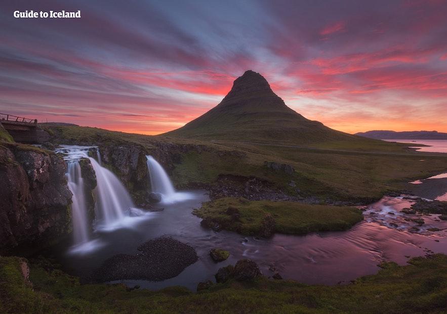 Kirkjufell and Kirkjufellsfoss waterfall at golden hour