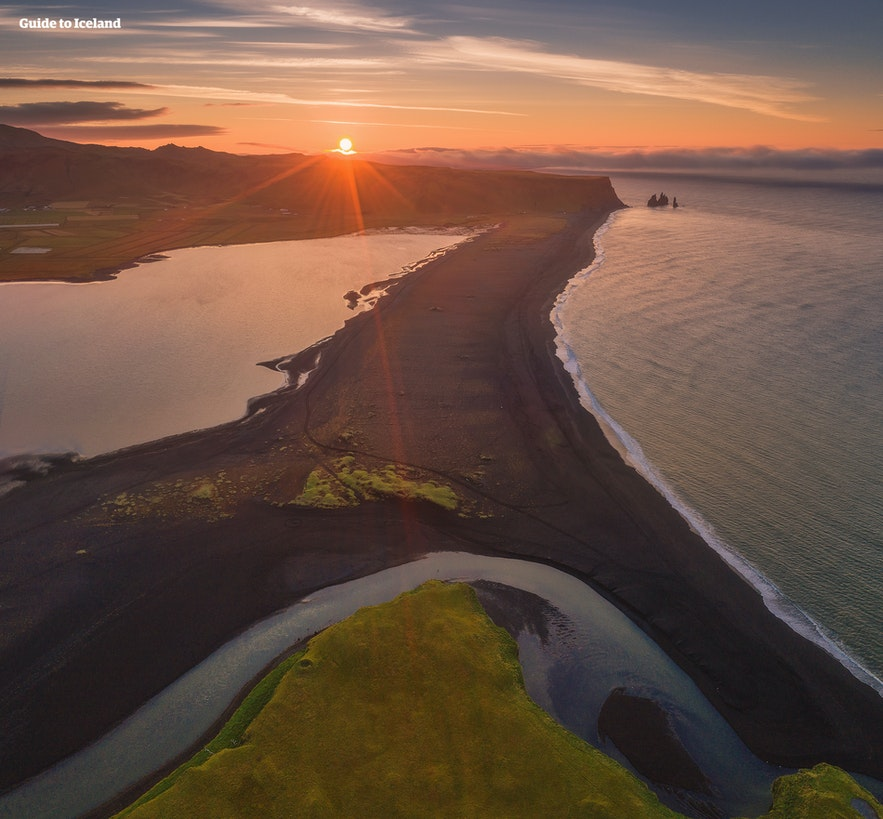 An aerial shot of Reynisfjara black sand beach in South Iceland at golden hour