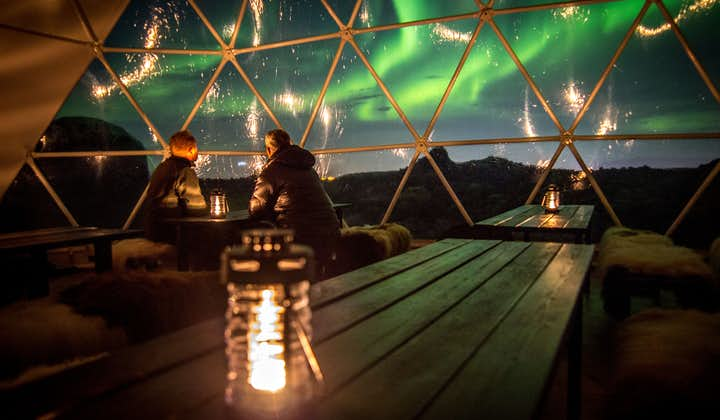 A couple gaze at the Northern Lights in the Observatory