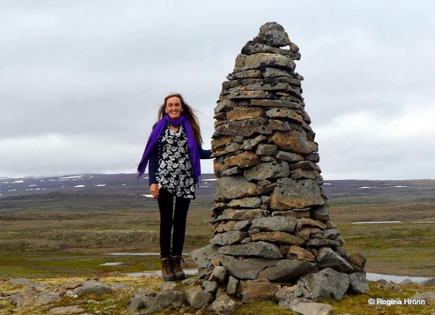 Regína by An old tall cairn on Þorskafjarðarheiði heath in the Westfjords of Iceland