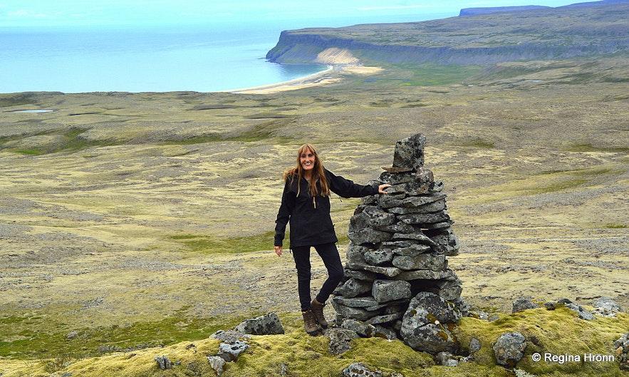 Regína by A big old cairn betweenLátrabjargand Keflavík in the Westfjords of Iceland