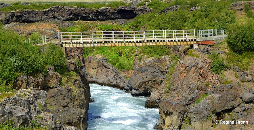 The pedestrian bridge by Barnafoss waterfall