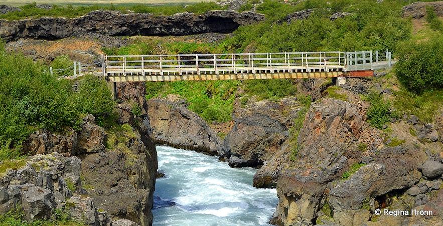 The pedestrian bridge by Barnafoss waterfall
