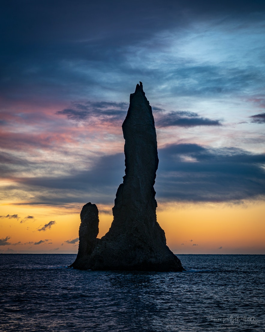 One of the Reynisdrangar sea stacks at sunrise.