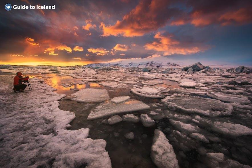 A photographer shoots Jokulsarlon glacier lagoon
