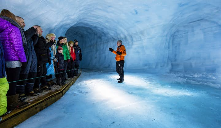A guide explaining the formation of glaciers to visitors.