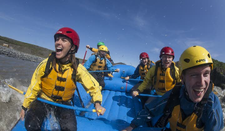 A group of people enjoying a river rafting tour in Iceland