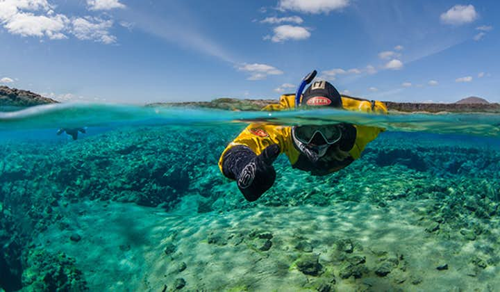 A person snorkelling in Silfra fissure