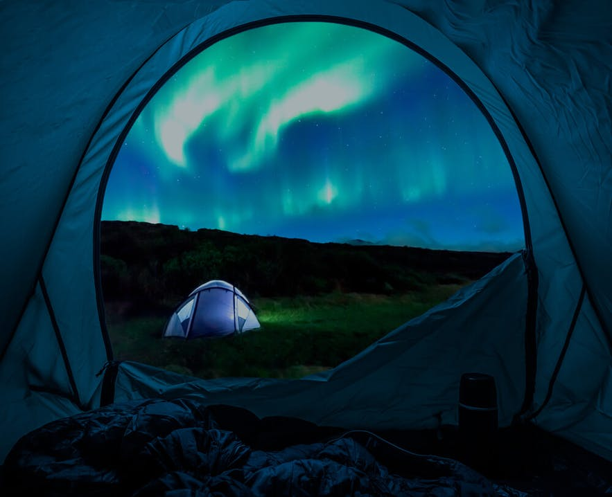 A view of the Northern in Lights in Iceland from a tent