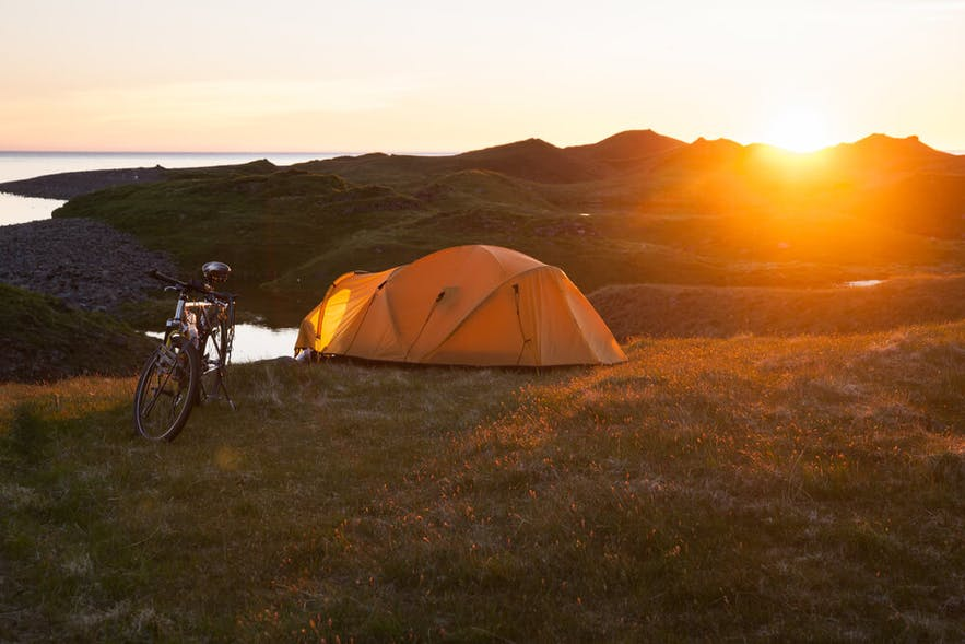 A tent in Iceland in the countryside under the Midnight Sun