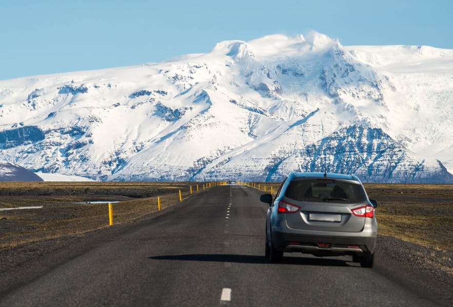 A car driving towards Vatnajokull in south Iceland