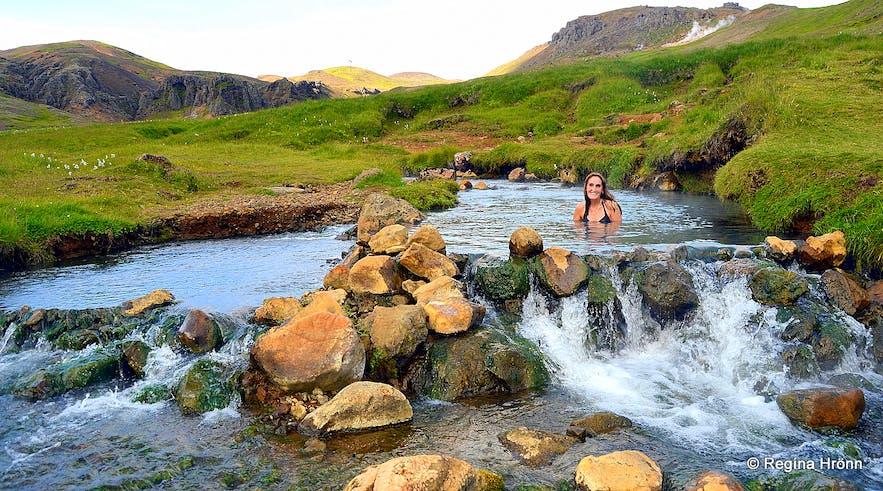 Reykjadalur valley geothermal area - Regína soaking in the hot river