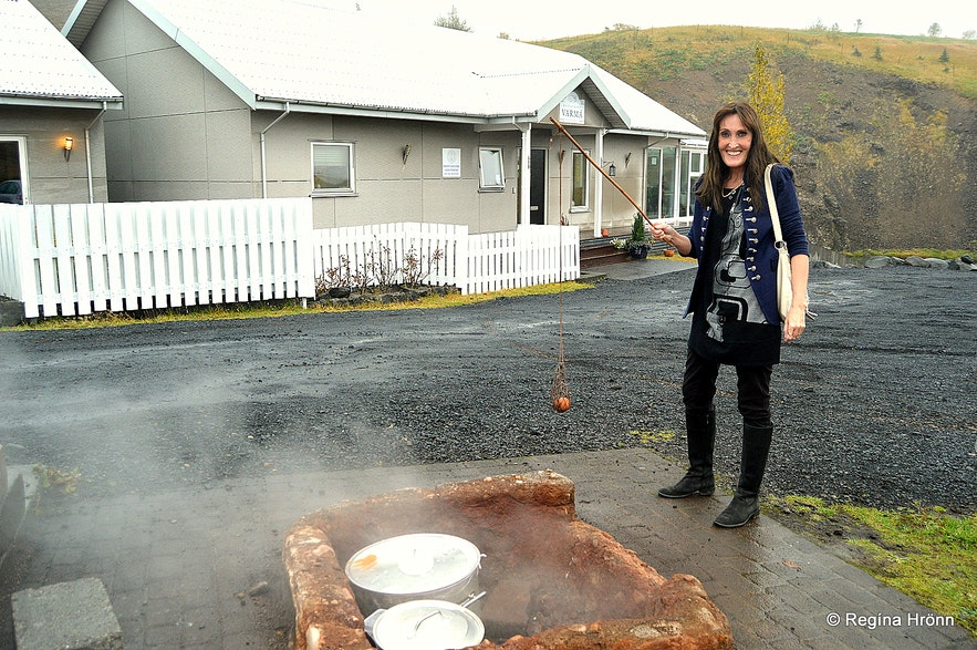 Regína boiling an egg in a hot spring