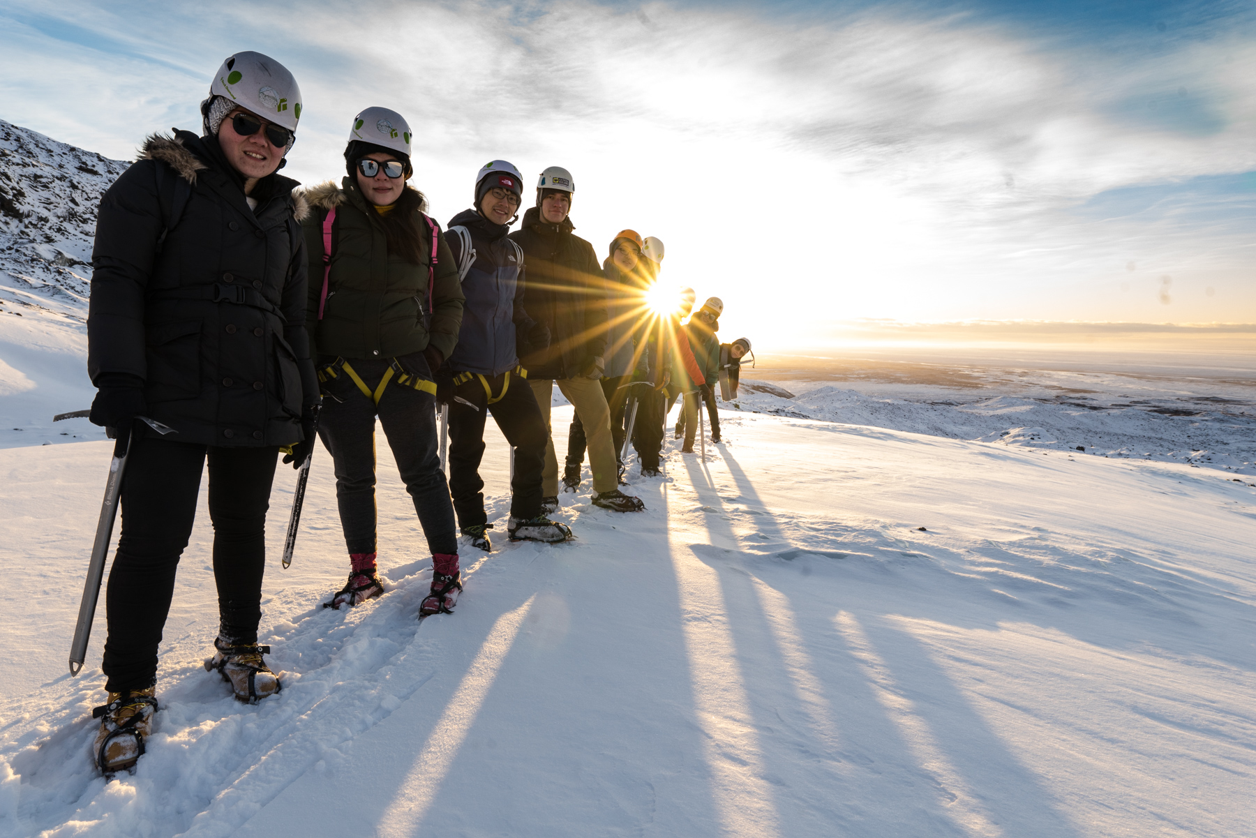 A group of people geared up for a glacier hike in Iceland