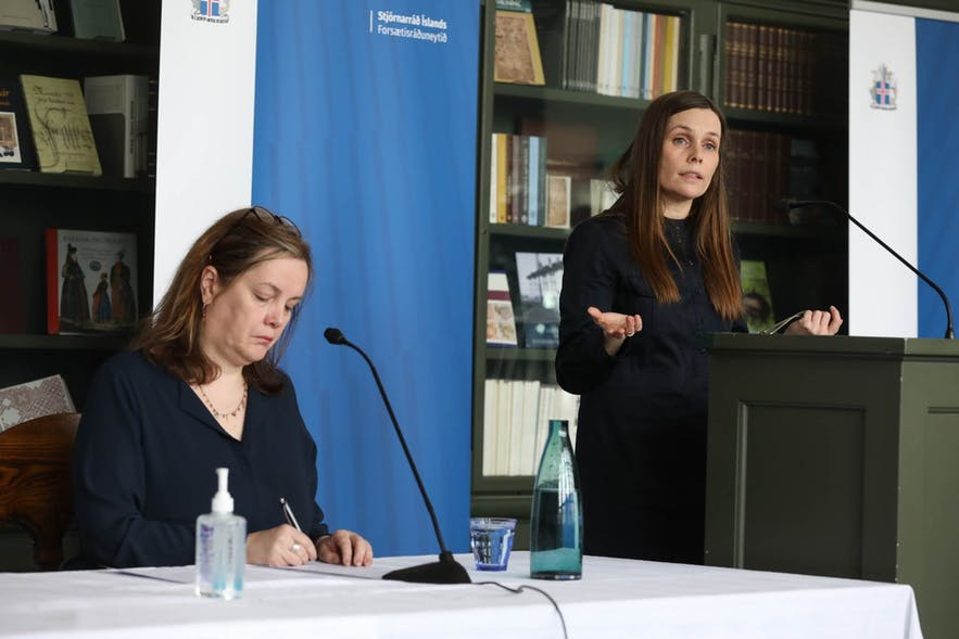 Prime Minister Katrin Jakobsdottir announcing the lifting of restrictions in a press conference.