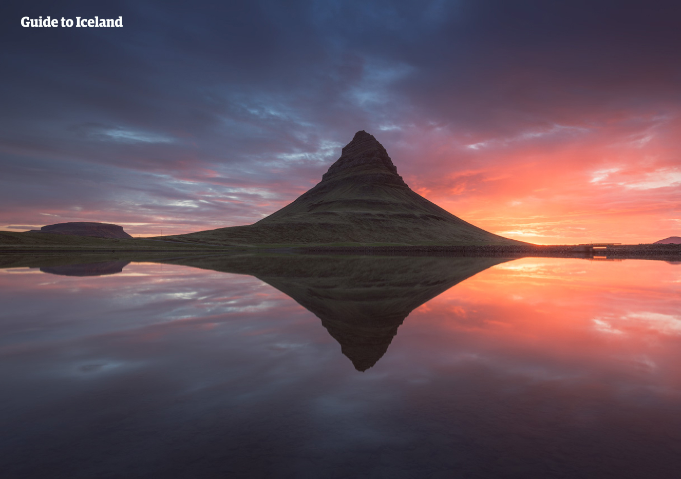 Kirkjufell Mountain on the Snaefellsnes Peninsula of Iceland pictured at sunset in summer.