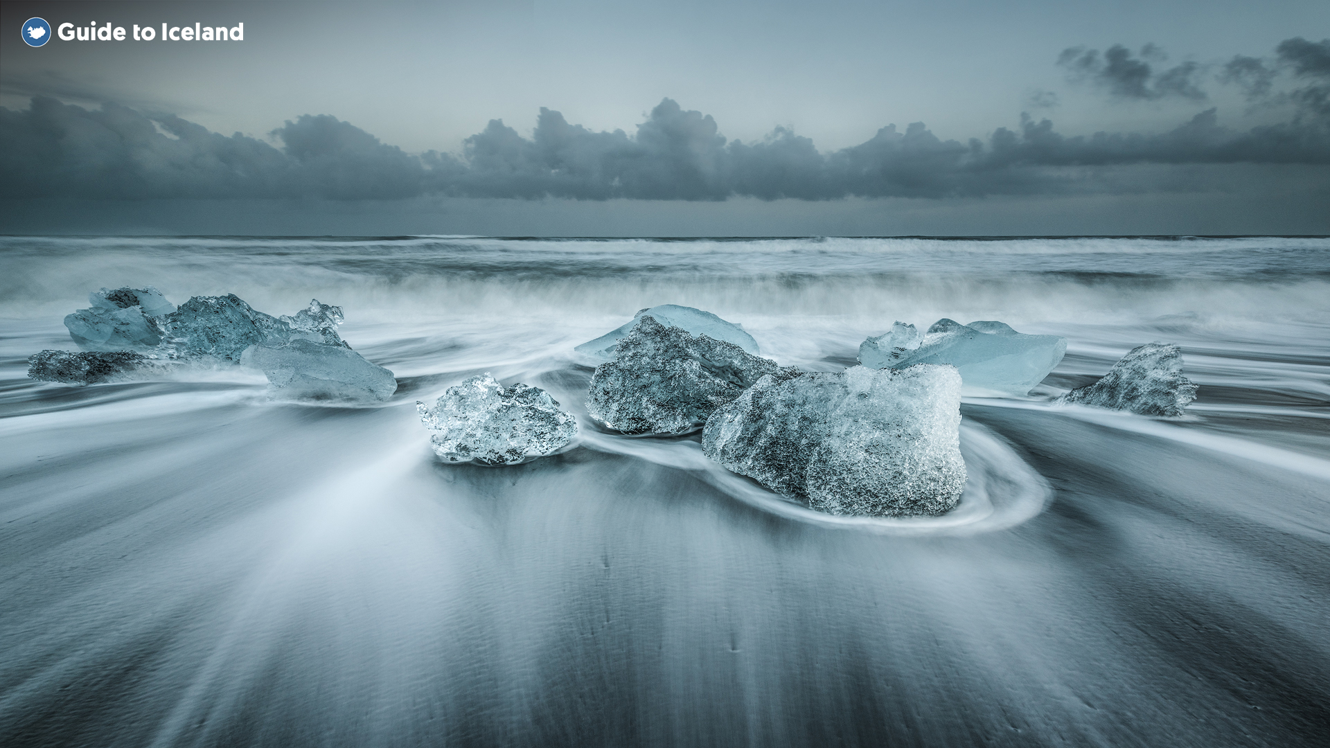Wind swept pieces of ice sitting on the shore of the Diamond Beach, a black sand beach in the South East of Iceland.