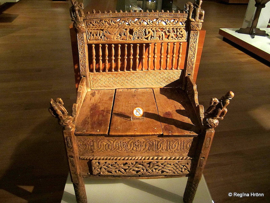 A carved wooden chair from Draflastaðakirkja church now at the National Museum of Iceland