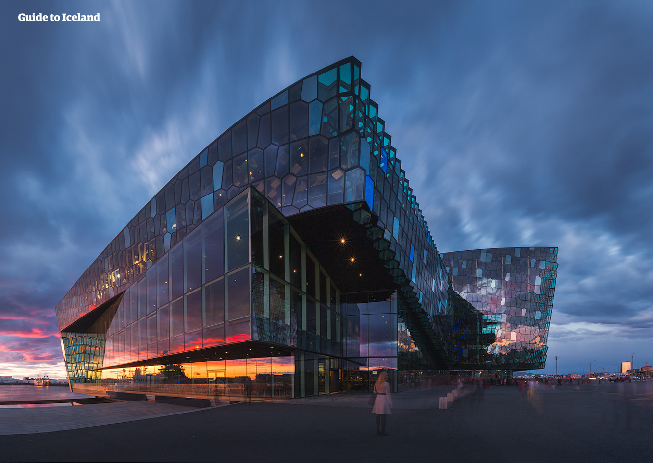 Harpa Concert Hall which sits on the shores of Reykjavik Harbour, photographed at sunset.