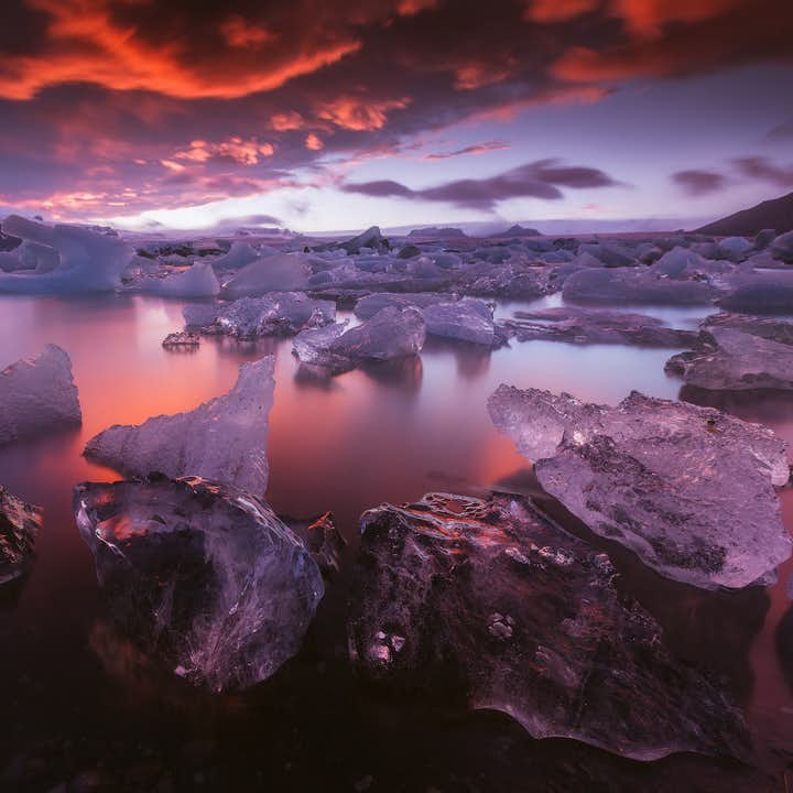 A pink sunset over the Jokulsarlon Glacier Lagoon in the South East of Iceland.
