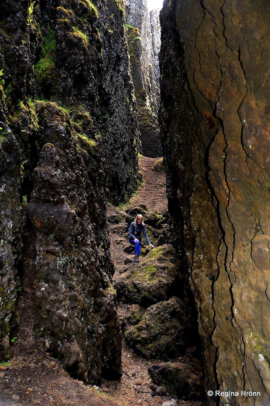 Regína hiking inside Lambafellsklofi rift in SW-Iceland