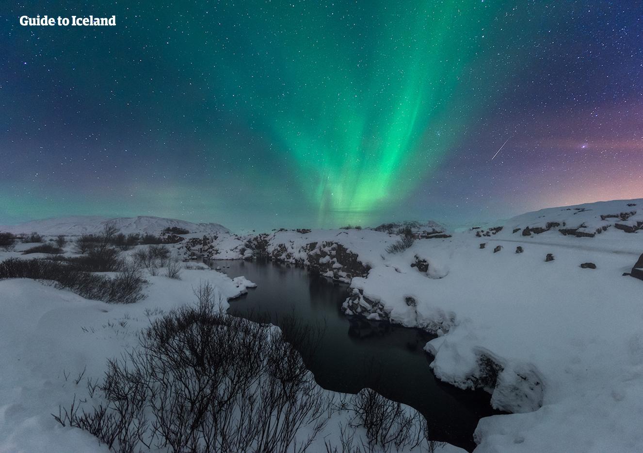 Thingvellir National Park in South West Iceland under a brilliant Aurora-filled sky.