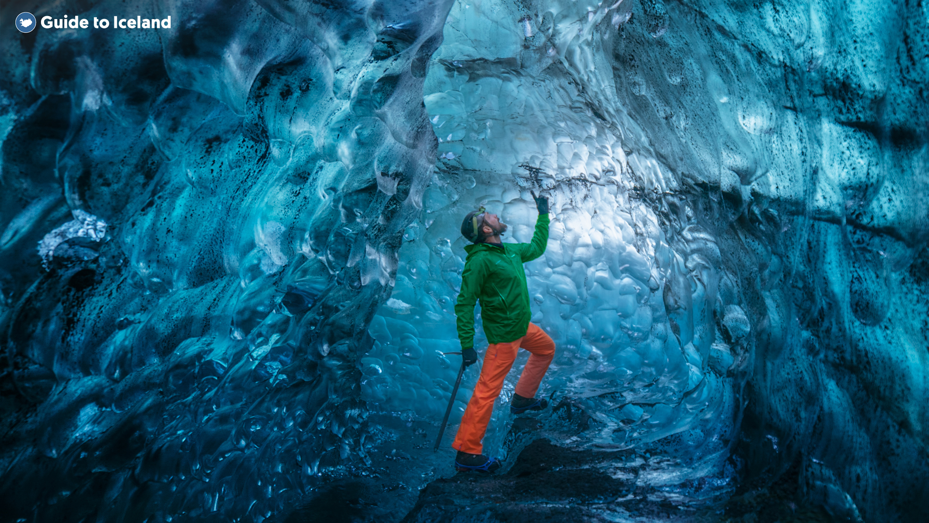 A visitor marvelling at the colours from the inside of an ice cave in Iceland.