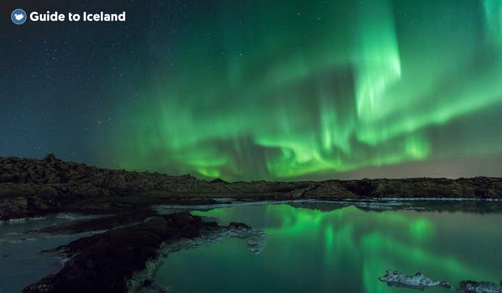 The Northern Lights dancing over a lake in Iceland.