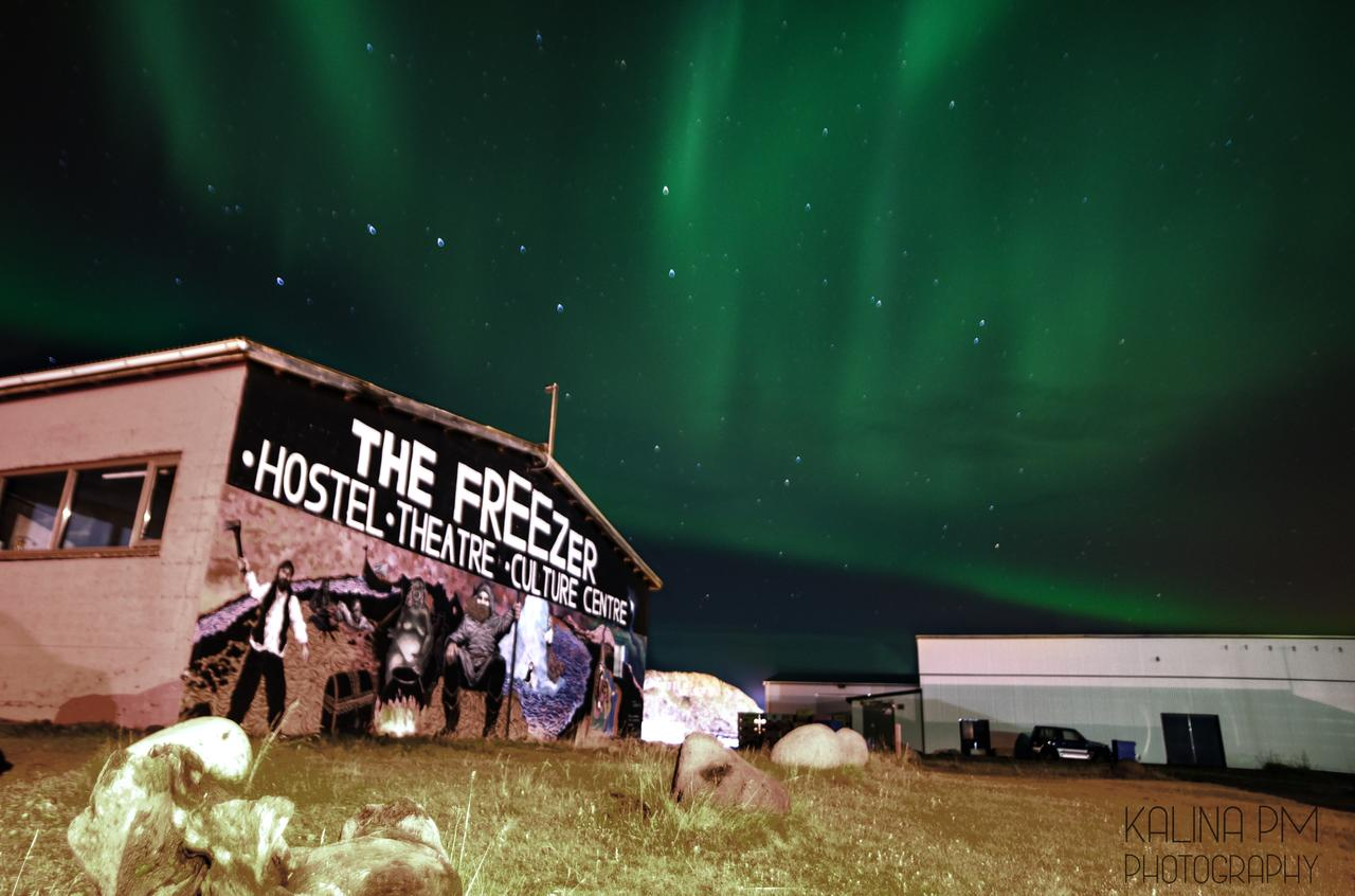 The Freezer Hostel, beneath the Northern Lights in Iceland.