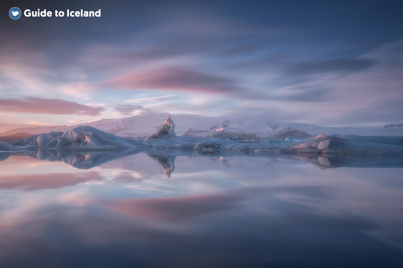 Jokulsarlon Glacier Lagoon is a vast body of water holding many icebergs.