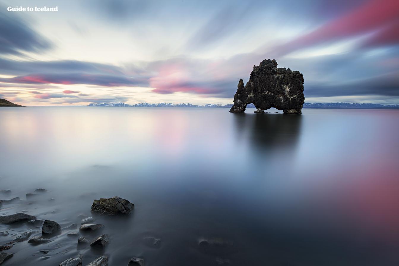 A beautiful sky dances over Hvitserkur rock monolith.