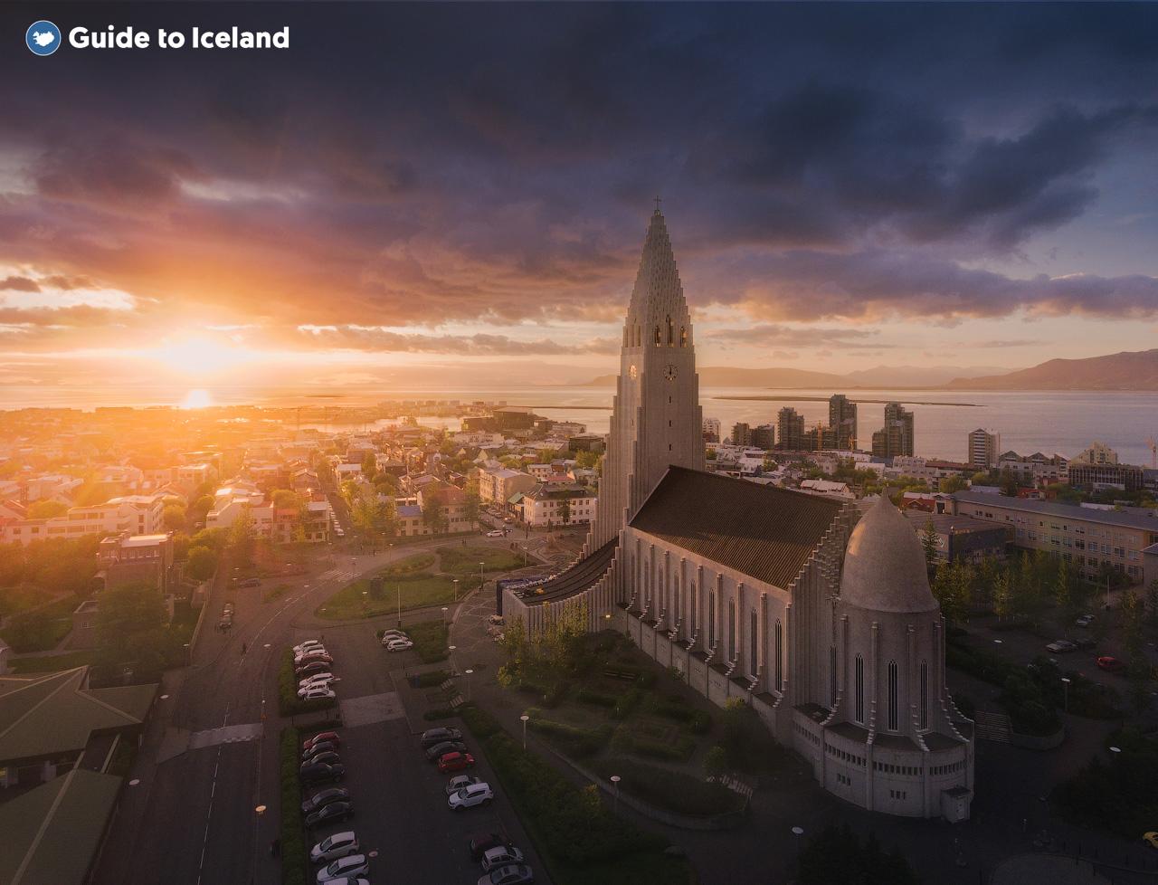 The Midnight Sun gleams on the church of Hallgrimskirkja in the city of Reykjavik.