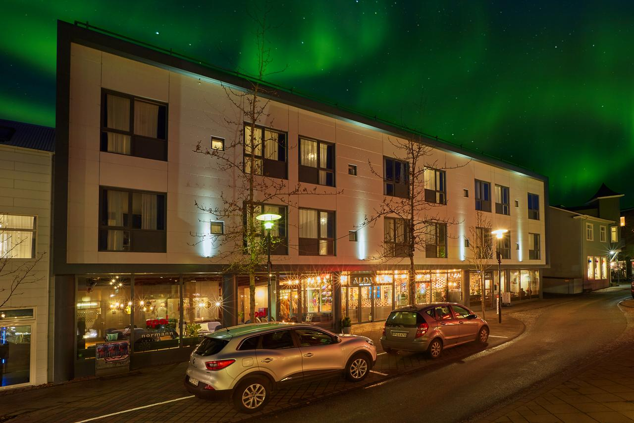 The Northern Lights dance over Alda Hotel Reykjavik.