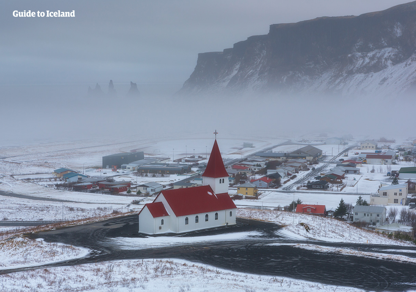 The fishing town of Vik is a popular destination on the south coast of Iceland. You can wait for the Northern Lights at night.