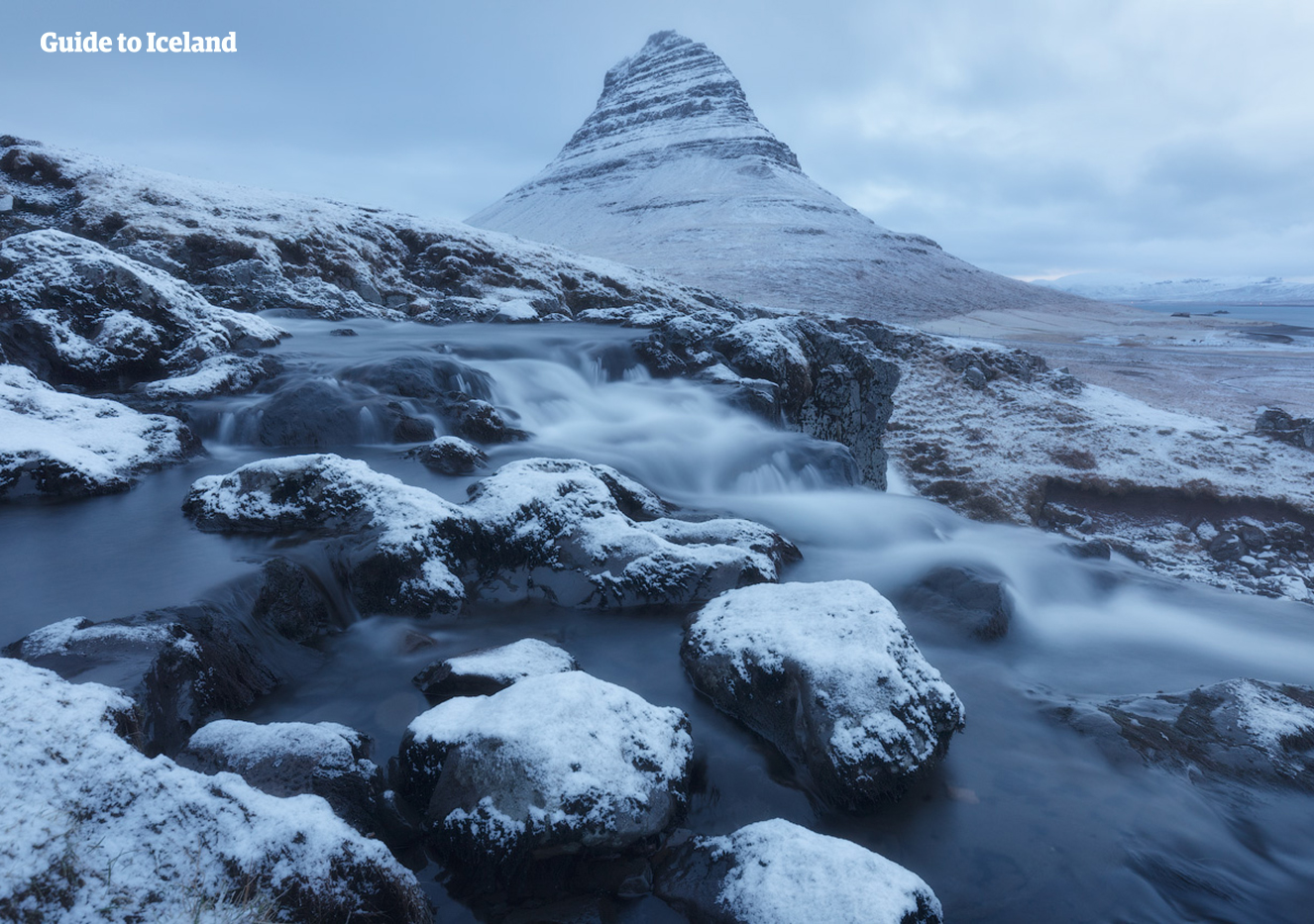 Kirkjufell, the Church Mountain, stands with a dusting of snow in winter.