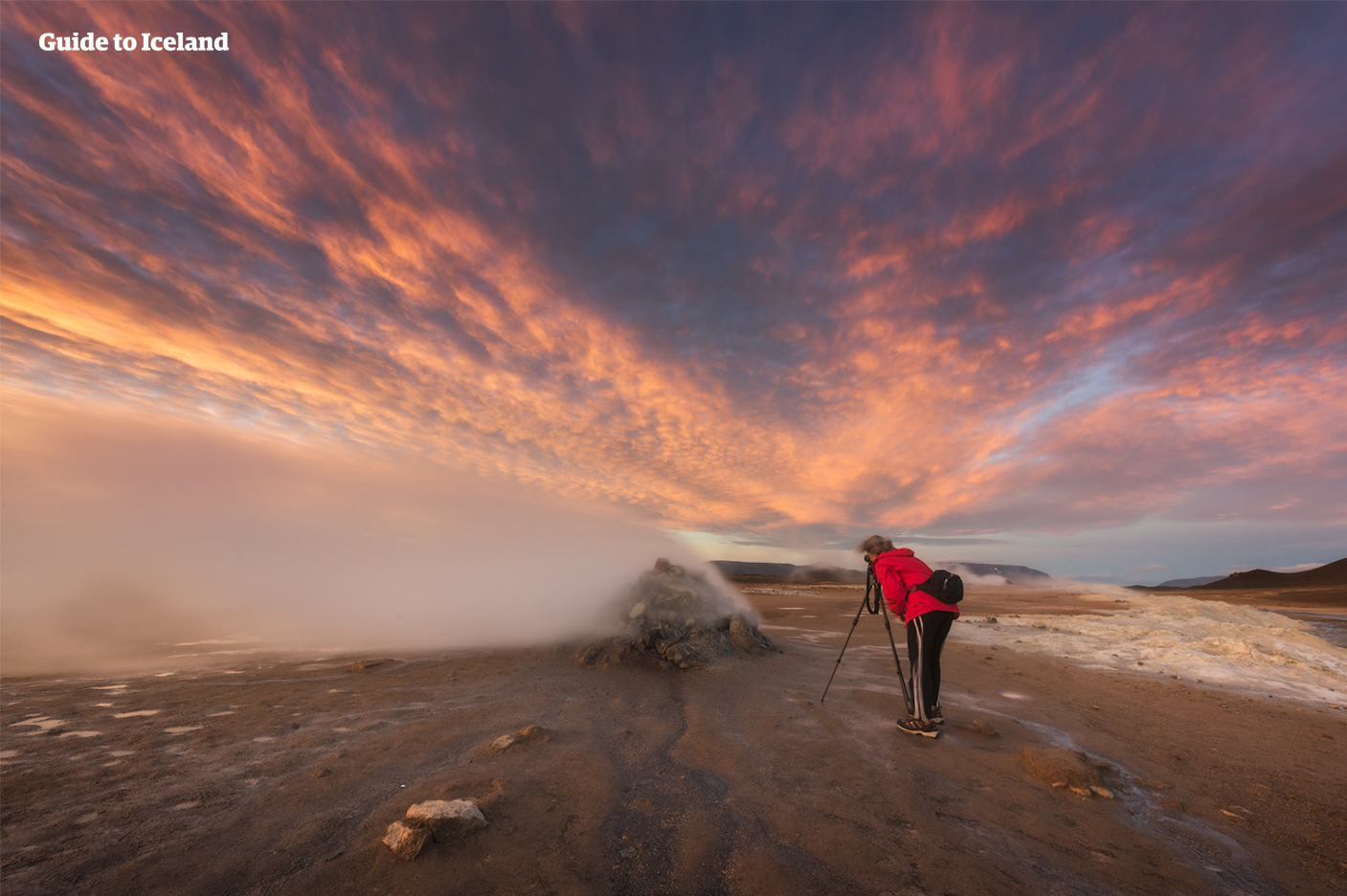 A visitor approaches a hissing fumarole at Namaskard Pass in Iceland's north.