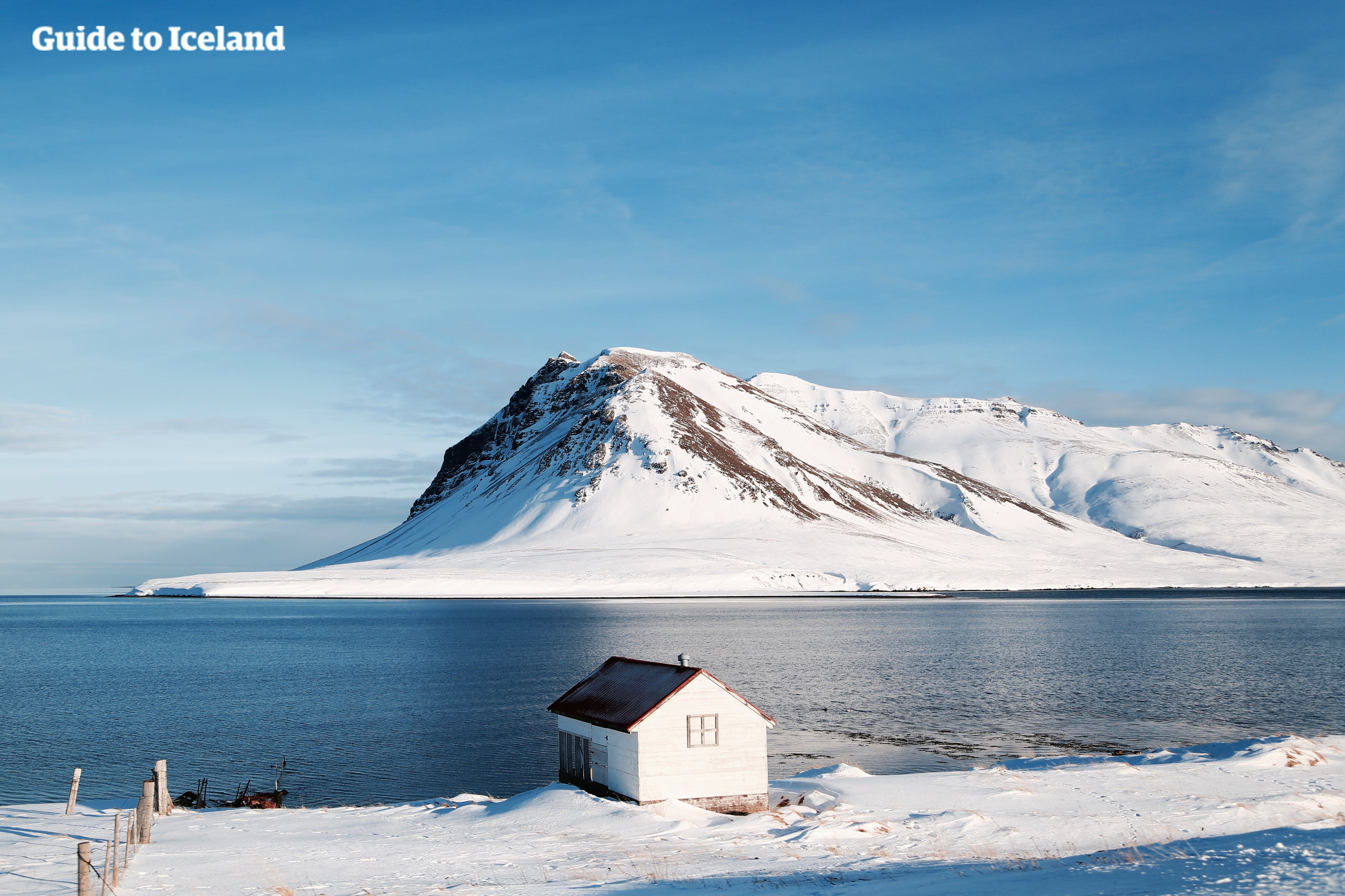 A house on the Snaefellesnes Peninsula overlooks a stunning seascape.