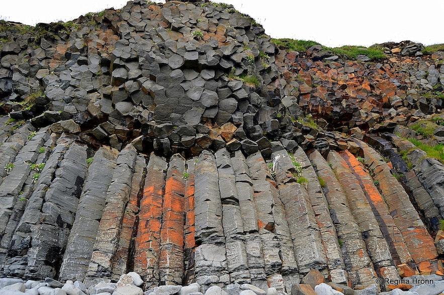 Basalt columns rise at Kálfshamarsvík beach.
