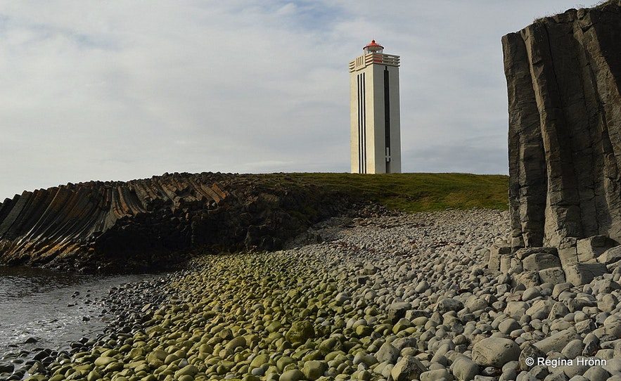 Kálfshamarsvík beach in Iceland has basalt columns and a lighthouse.