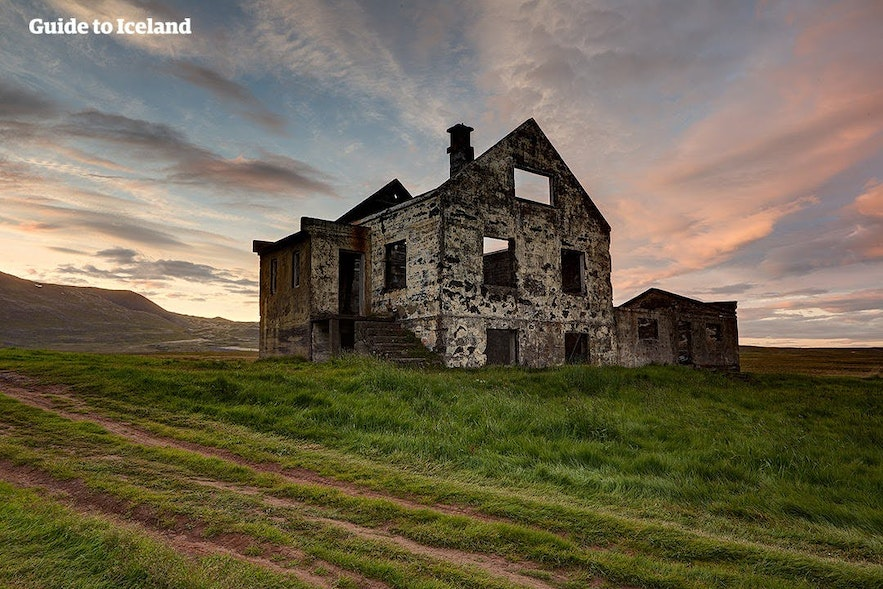 An abandoned house is slowly reclaimed by nature in East Iceland.